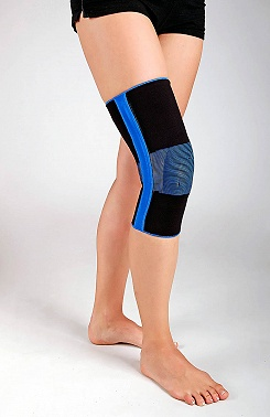 Knee brace, short with spring reinforcements