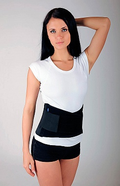 Lumbar belt with reinforcements and support traction